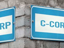 S-corp vs. C-corp sign